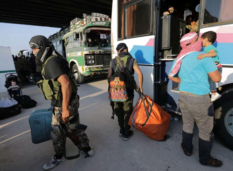 خروج المعارضة من القنيطرة تزامنا مع تقدم النظام السوري