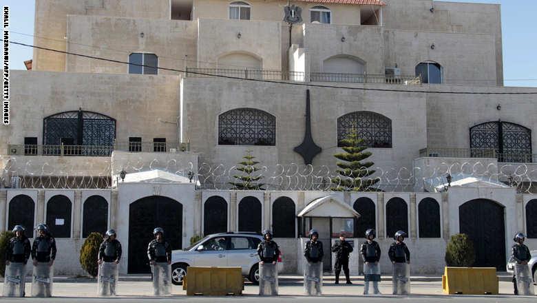 Jordanian riot policemen stand guard out